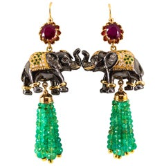 42.60 Carat White Diamond Emerald Ruby Tsavorite Yellow Gold Elephants Earrings