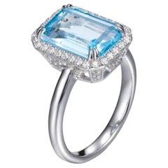 4.27 Carat Emerald Cut Blue Topaz Round Brilliant Halo Claw Set Ring Art Deco