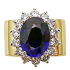 4.27 Carat Oval Sapphire and Diamond Halo Gold Cocktail Ring