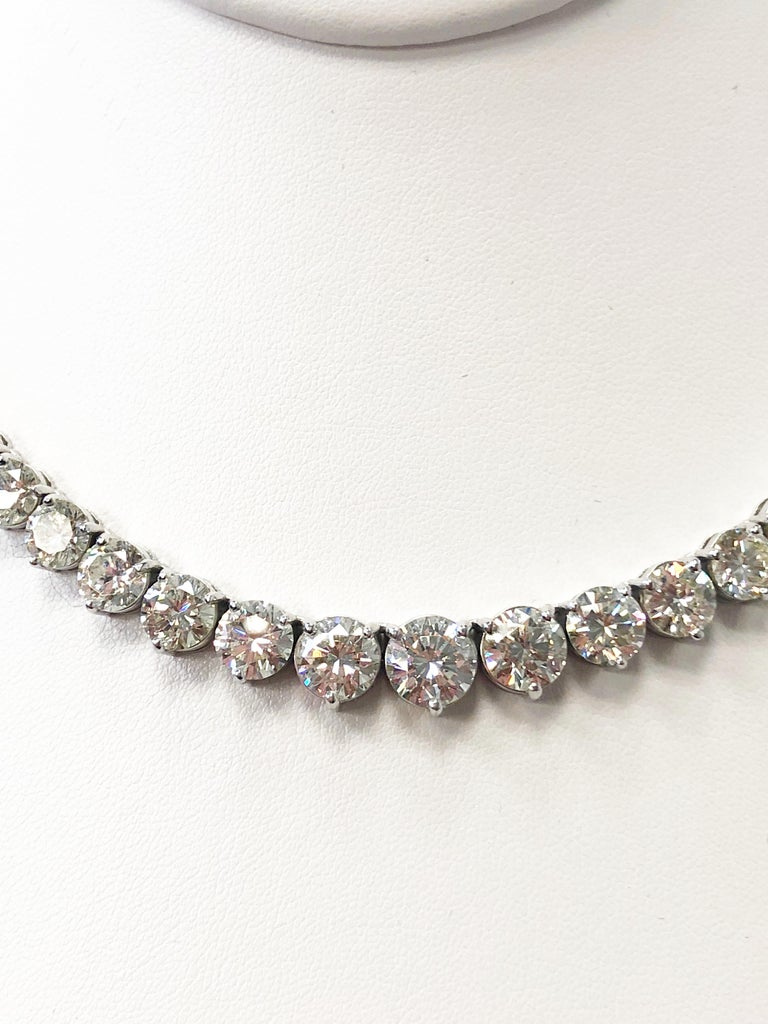 Gorgeous riviera necklace with approximately 43 carats of brilliant white round diamonds.  Diamonds are good quality and graduating sizes.  Handcrafted 18k white gold mounting is delicate and well made.  Perfect staple piece to add to any jewelry