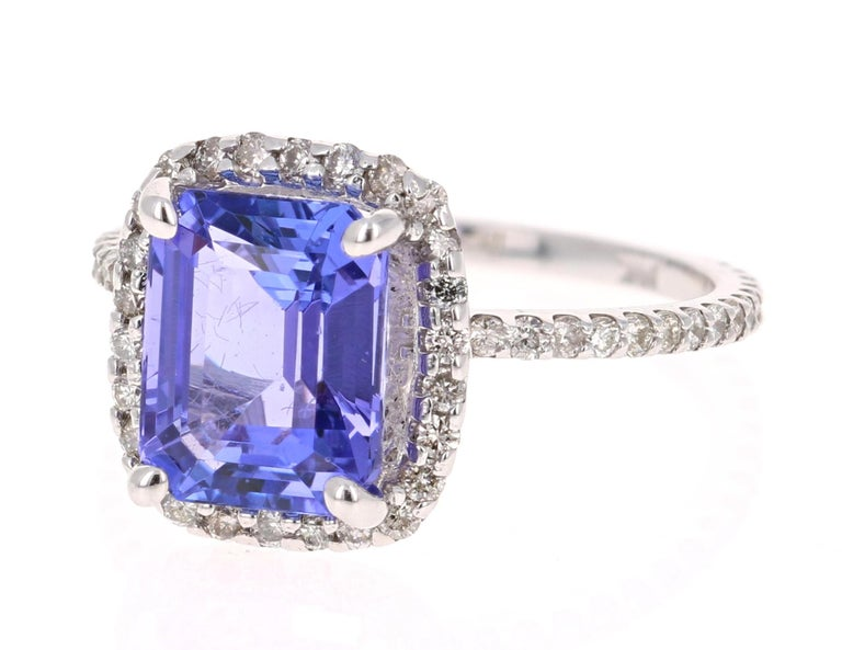 A gorgeous 4.30 Carat Tanzanite and Diamond Ring that can easily transform into a unique Engagement Ring for that special someone!  The Tanzanite is an Emerald cut stone and weighs 3.62 carats.  The ring is surrounded by a Halo of 74 Round Brilliant