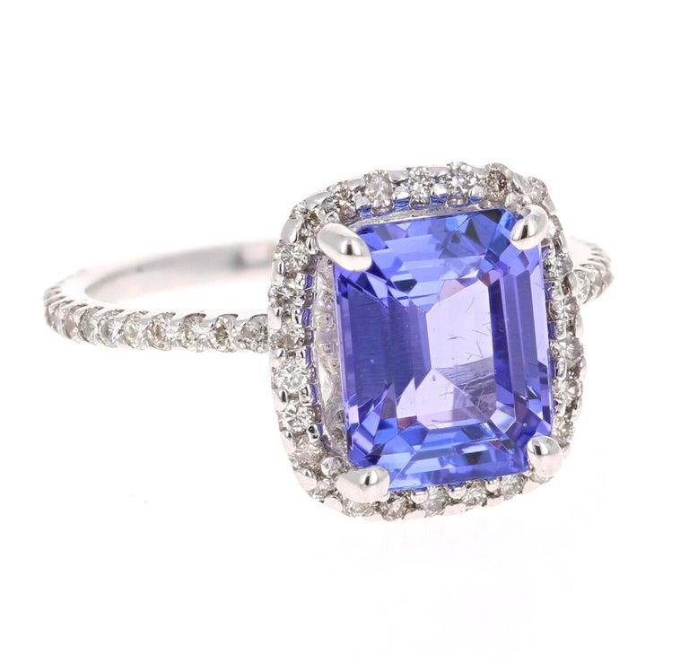 Modern 4.30 Carat Emerald Cut Tanzanite Diamond 14 Karat White Gold Engagement Ring For Sale