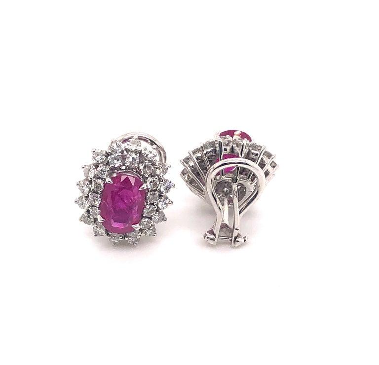 Oval Cut 4.32 Carat Oval Rubies and 1.80 Carat Diamond Stud Earrings, 14 Karat White Gold For Sale