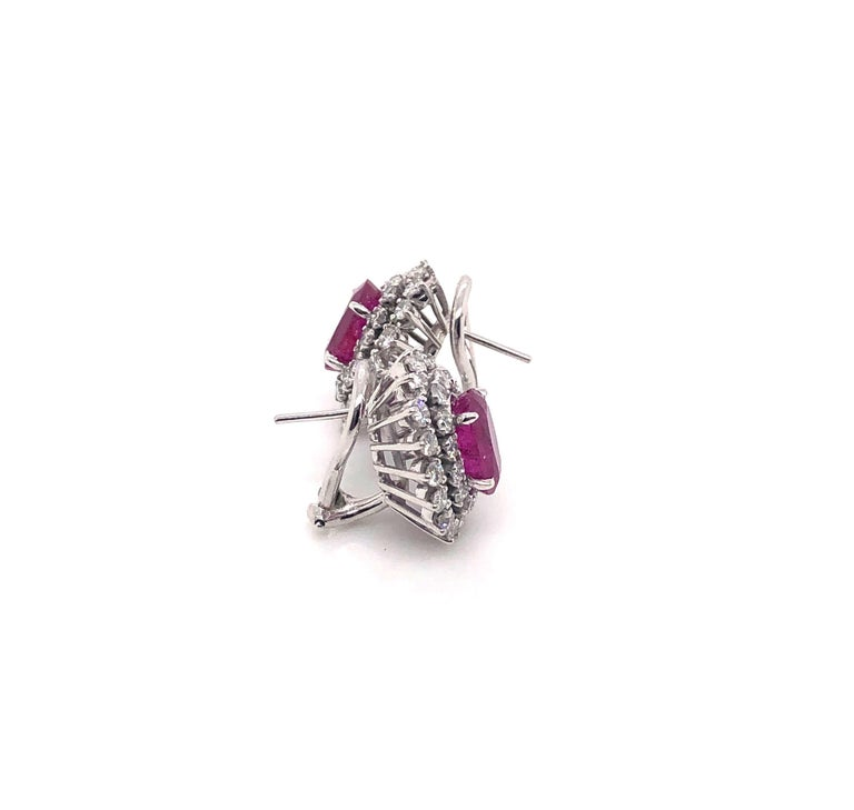 Women's 4.32 Carat Oval Rubies and 1.80 Carat Diamond Stud Earrings, 14 Karat White Gold For Sale
