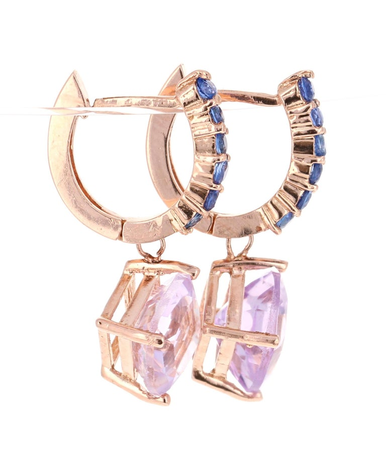 Amethyst and Blue Sapphire Drop Earrings!   These stunning earrings have 2 Amethysts that weigh 3.80 Carats and are embellished with 12 Blue Sapphires that weigh 0.53 Carats. The total carat weight of the earrings are 4.33 Carats.   They are