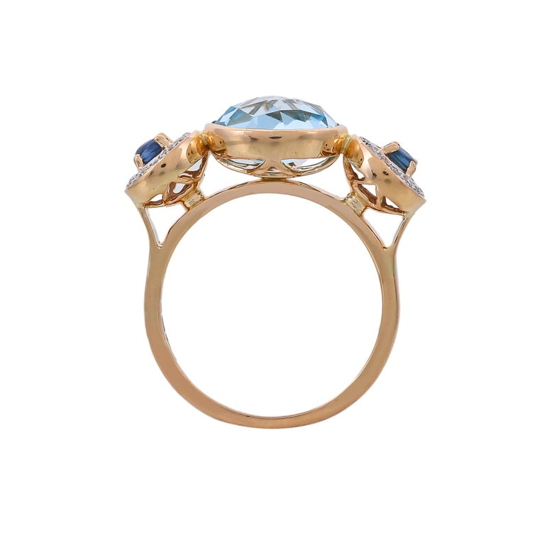 Mounted in 18 karats yellow gold, this simple and elegant ring is from the collection 'Bonbon'. This ring revolves around simplistic designs concept with just accents of 0.16 carats diamonds, 0.29 carats blue sapphire and 4.36 carats blue topaz.