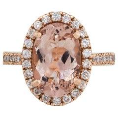 4.39 Carat Oval Cut Morganite Ring with Diamond Halo 14 Karat in Stock