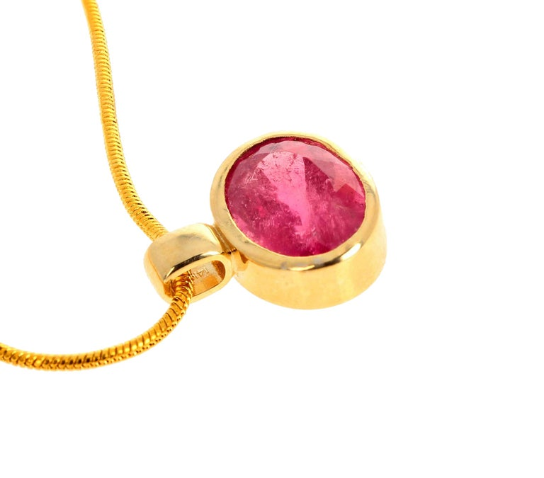 Glittering natural 4.4 Carat Brasilian Rubelite Tourmaline set in an 18Kt yellow gold pendant.  There are no eye visible inclusions and the gemstone measures 12 mm x 8.4 mm.