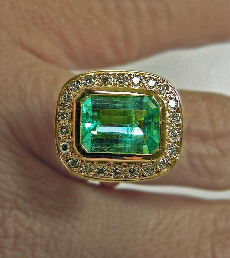 4.40 Carat Emerald Cut Colombian Emerald Diamond Halo Ring 18 Karat Gold Primary Stone: Natural Colombian Emerald Shape or Cut: Emerald Cut Emerald Weight: Approx. 4.00 Carats Measurements Emerald: 11.00mmx8.00mm Average Color/Clarity Emerald:
