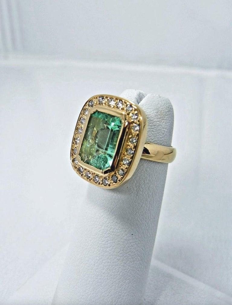 Women's 4.40 Carat Emerald Cut Colombian Emerald Diamond Halo Ring 18 Karat Gold For Sale