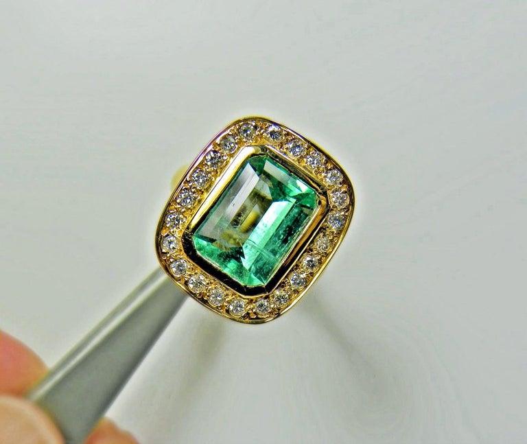 4.40 Carat Emerald Cut Colombian Emerald Diamond Halo Ring 18 Karat Gold For Sale 3