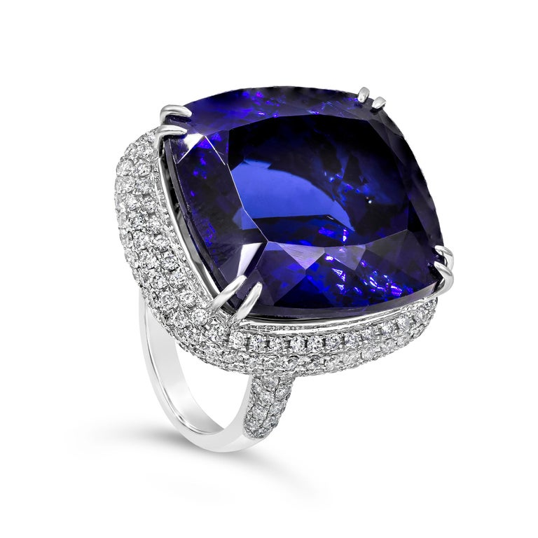 An important cocktail ring showcasing an amazing 44.04 carat cushion cut tanzanite, elegantly set in an intricately designed micro-pave setting. Diamonds weigh 2.43 carats total. Made in 18 karat white gold.  Style available in different price