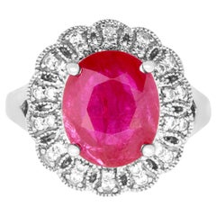 4.42 Carat Oval Ruby and 0.34 Carat White Diamond Ring