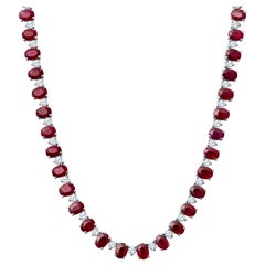 44.49 Carat Oval Ruby and 6.90 Carat in Round Diamond 14 Karat Gold Necklace