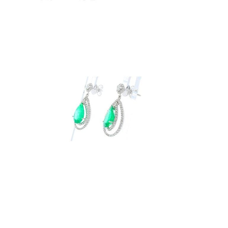 Contemporary 4.45 Carat Total Pear Shape Emerald and Diamond Earrings in 18 Karat White Gold For Sale