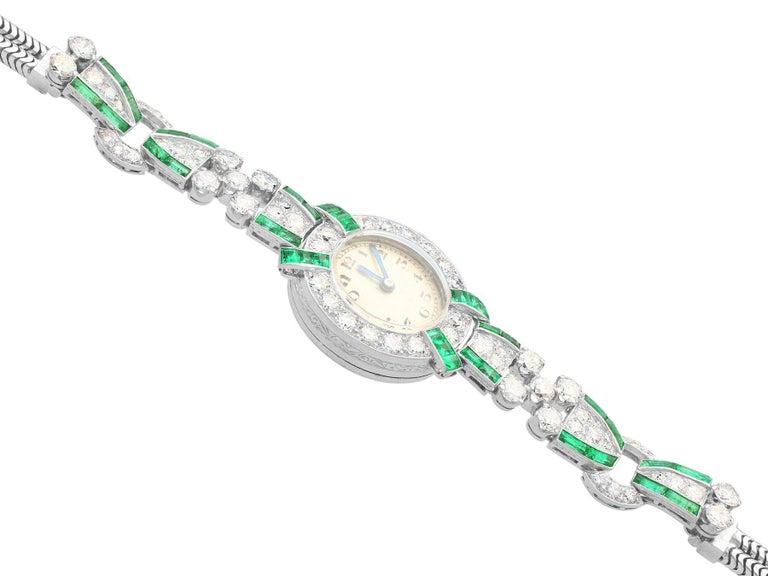 Round Cut 4.46ct Diamond and 1.61Ct Emerald Cocktail Watch in Platinum Circa 1953