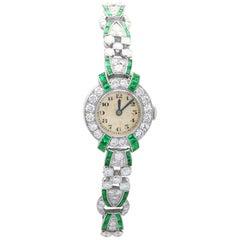 4.46ct Diamond and 1.61ct Emerald Cocktail Watch in Platinum, Circa 1953