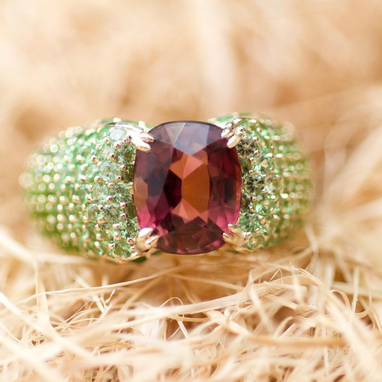 Sometimes the most unusual color combinations become the most beautiful.  Peach-burgundy tourmaline, three shades of tsavorites and yellow gold. You should not be afraid of vivid colors combinations, they always make the strongest impression. It is