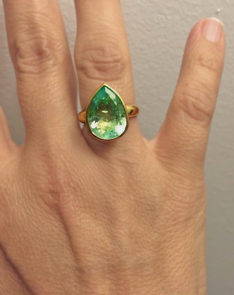 Primary Stone: Natural Colombian Emerald Shape or Cut: Pear Cut  Emerald Weight: 4.50 Carats (1 emerald) Measurements Emerald: 15.00mm x 12.00mm Average Color: Natural Light Green  Average Clarity: VS (Type III) Accent Stones: None  Ring