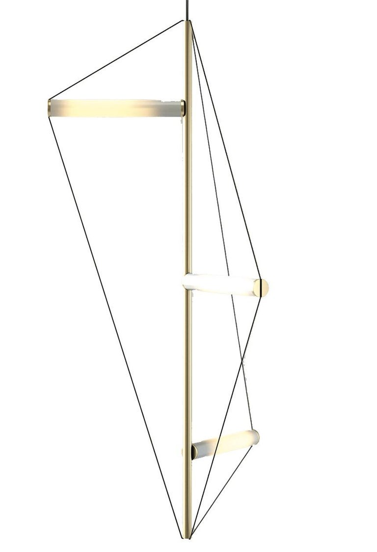 This magnificent ceiling light fixture will make a statement in any decor and is particularly suitable for a contemporary decor, thanks to its geometric lines and Minimalist design. Its structure is made of a vertical brass rod to which