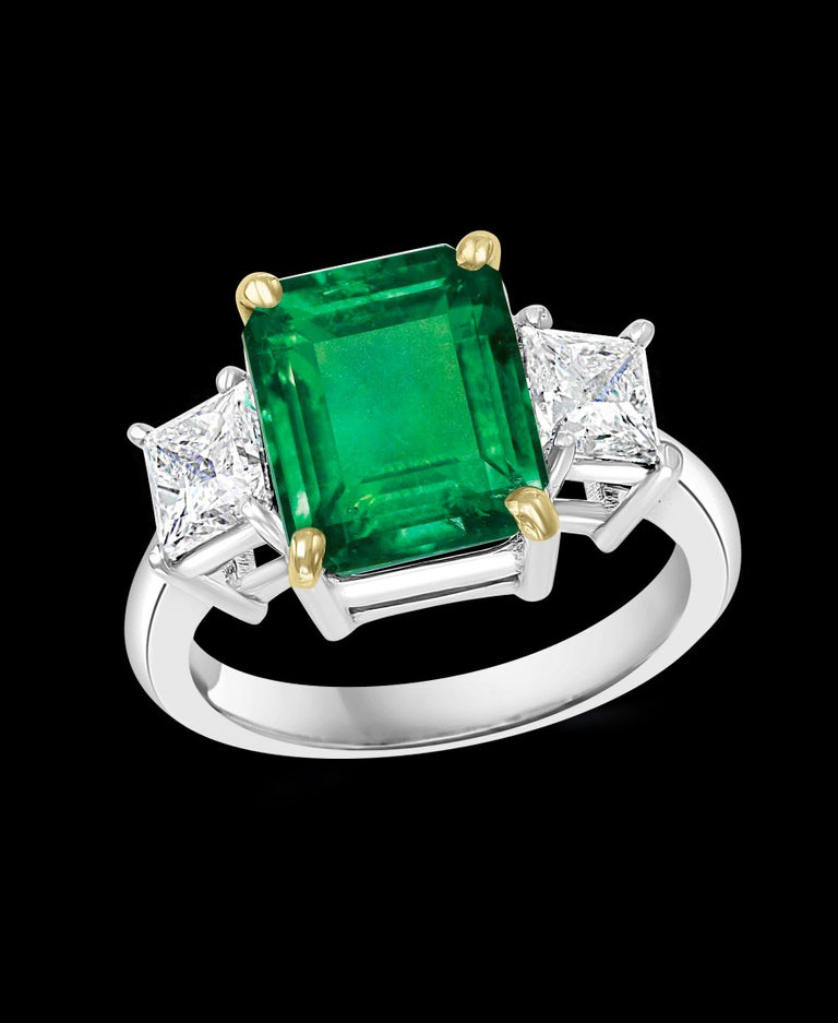 4.5 Carat Emerald Cut Colombian Emerald Diamond 18 Karat White gold Ring Estate piece Natural Emerald  Two Emerald cut Diamonds on either side of the Emerald.  18 K White gold 6.2 Gm 2 Diamonds: approximate 1.4 ct, Total weight   0.7 ct each