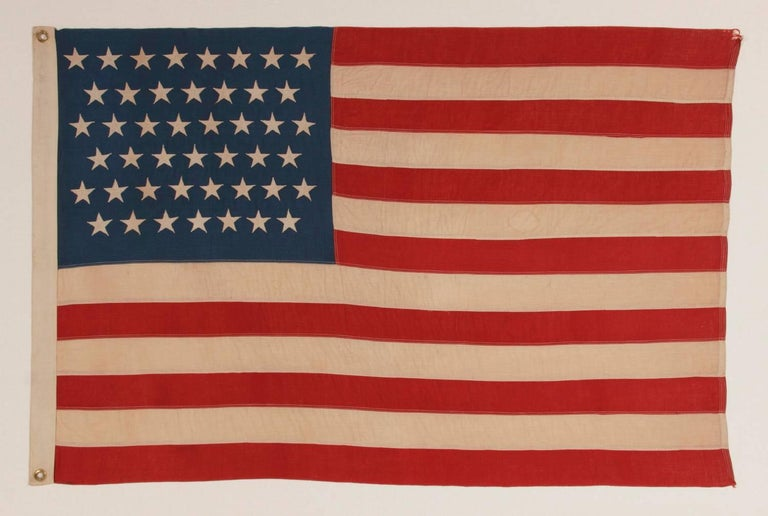 45 stars on an especially attractive denim blue canton, a beautiful example of a cotton bunting flag of this period, 1896-1908, Spanish-American war era, Utah statehood:  45 star American national flag, made of cotton, in a desirable small scale