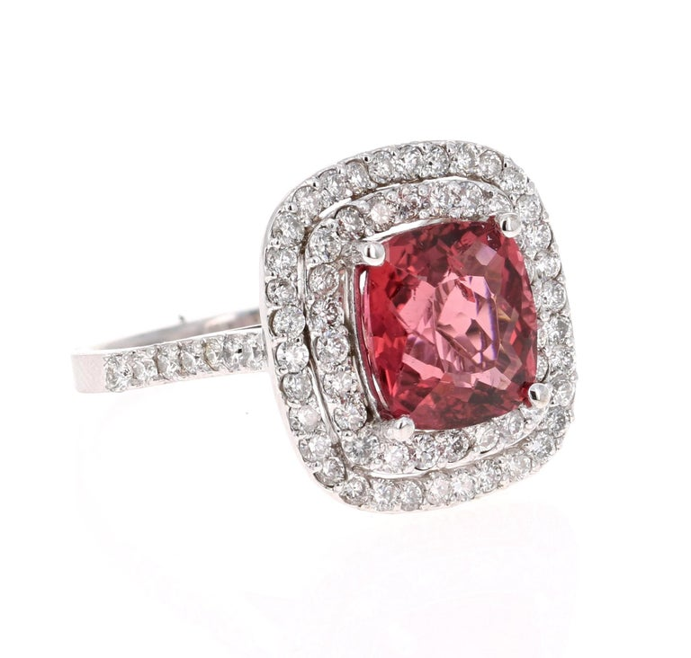 Gorgeous & Unique Cocktail Ring!  This ring has a pretty Cushion Cut Orangish-Mauve Tourmaline that weighs 3.34 Carats. Floating around the tourmaline is 72 Round Cut Diamonds that weighs 1.16 Carats. The total carat weight of the ring is 4.50