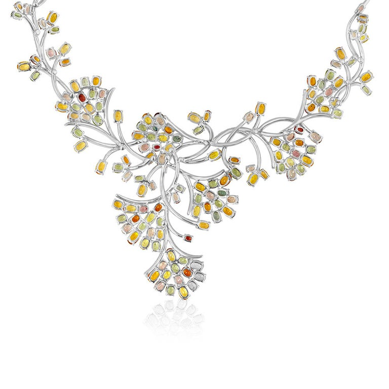 """Red Carpet Necklace The necklace is 18K White Gold There are 5.00 Carats in Diamonds F/G VS There are over 40.00 Carats in Multi-Color Sapphires The necklace is 16"""" in circumference on the inside. The necklace weighs 99.5 grams"""