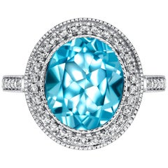 4.50ct Oval Blue Topaz Engagement Ring 0.33 Carat Round Diamond 18ct White Gold
