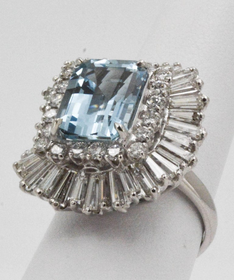 Crystal clear waters would not capture your attention more than this 4.51 ctw emerald cut Aquamarine. Its universal appeal in soft blue is complemented with 20 round brilliant cut diamonds and 40 tapered bagguette diamonds (3.75 carat total weight,