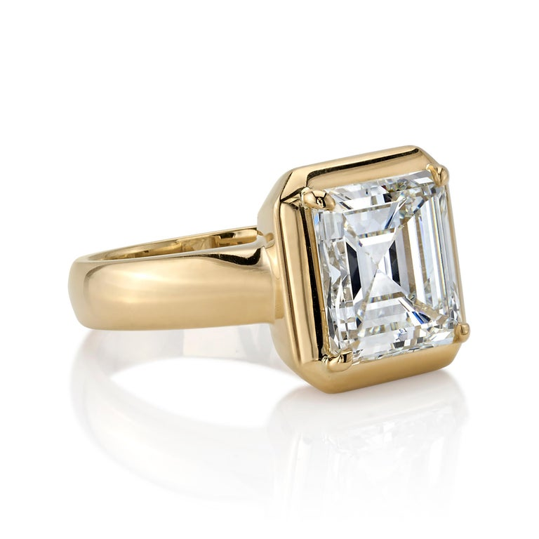 4.51ctw K/VVS2 GIA certified Asscher cut diamond set in a handcrafted 18K yellow gold mounting.  Ring is currently a size 6 and can be sized to fit.