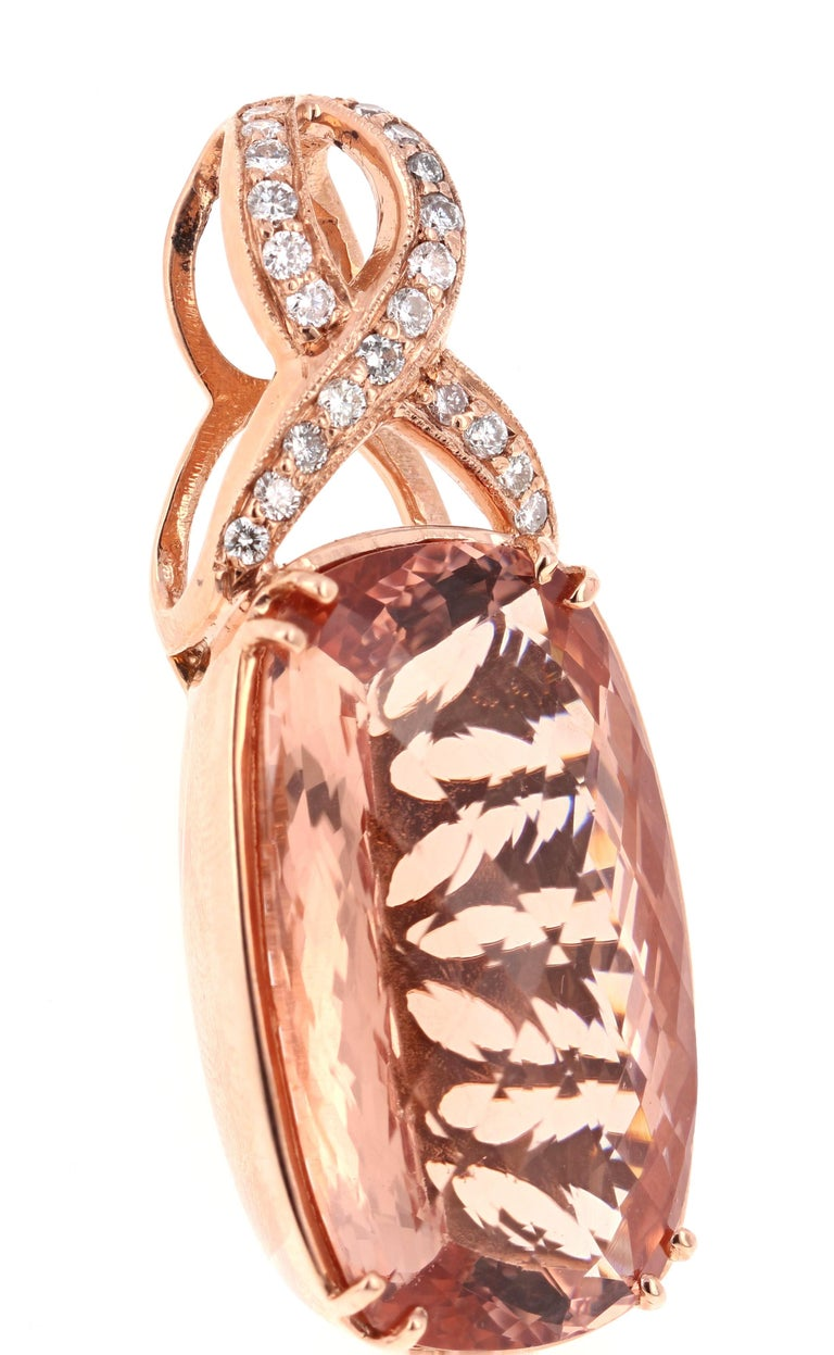This uniquely designed Pendant has an exceptionally large Oval Cut Morganite that weighs 44.55 carats and it is accented by 27 Round Cut Diamonds that weigh 0.80 carats.  The Pendant is made in 14K Rose Gold and weighs approximately 17.0 grams.
