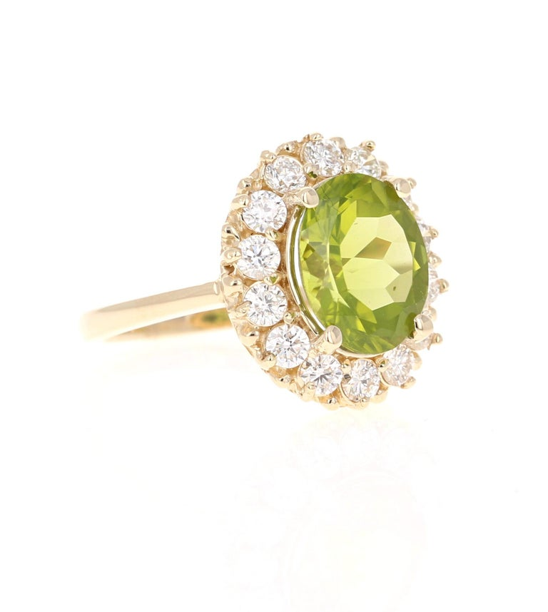 This Peridot and Diamond Ring has a 3.58 Carat Oval Cut Peridot set in the center and has 14 Round Cut Diamonds weighing 0.96 Carats.  The Clarity and Color of the diamonds is SI1/ F. The total carat weight of the ring is 4.54 Carats.   It is set in