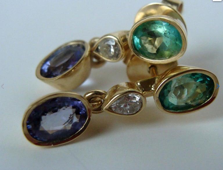 Oval Cut 4.55 Carat Colombian Emerald Tanzanite and Diamond Dangle Earrings 18 Karat For Sale