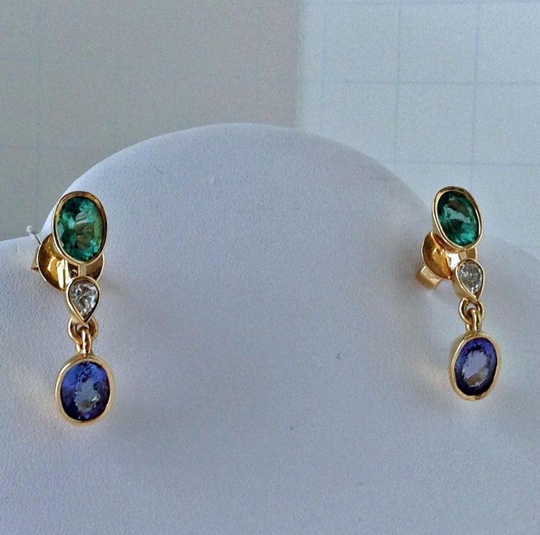 4.55 Carat Colombian Emerald Tanzanite and Diamond Drop Dangle Earrings 18K  This ELEGANT pair of earrings feature two natural Colombian Emerald oval cut 1.75ct medium light green VS, two natural diamond pear cut 0.50ct VS and two natural Tanzanite