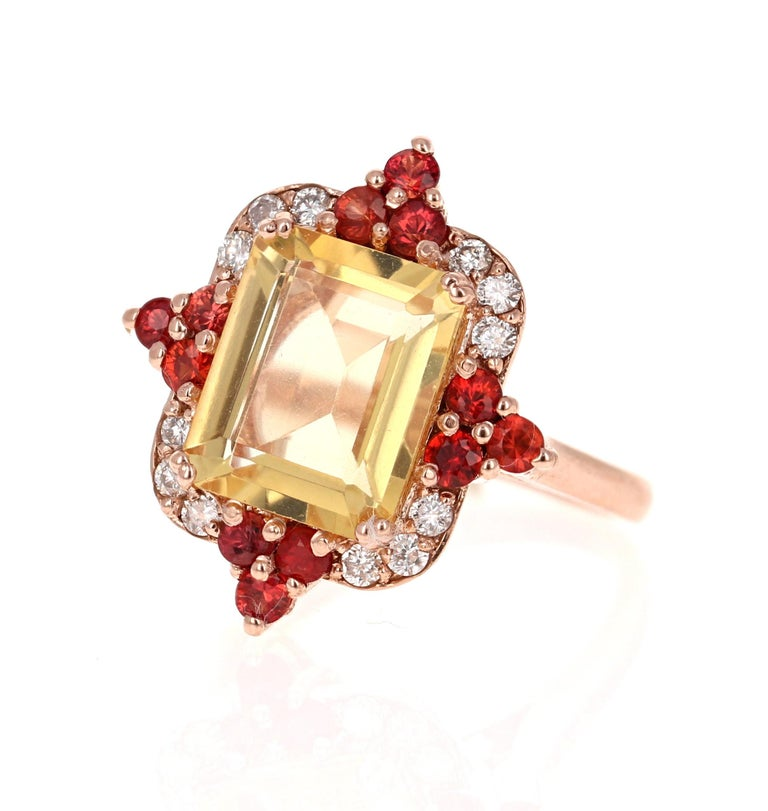 A stunning piece that can be a great alternative to a Yellow Diamond!  This gorgeous ring has a beautiful Emerald Cut Citrine Quartz weighing 3.57 Carats and is surrounded by 12 Round Cut Red Sapphires weighing 0.72 Carats and 12 Round Cut Diamonds