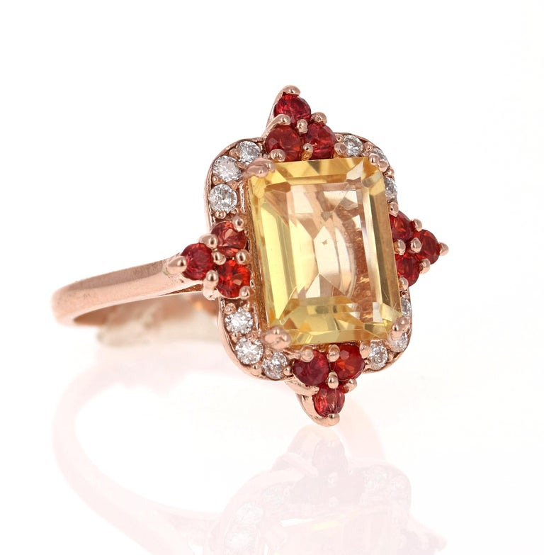 Modern 4.55 Carat Emerald Cut Citrine, Sapphire and Diamond 14 Karat Gold Ring For Sale