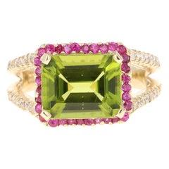 4.56 Carat Emerald Cut Peridot Sapphire and Diamond 14 Karat Yellow Gold Ring