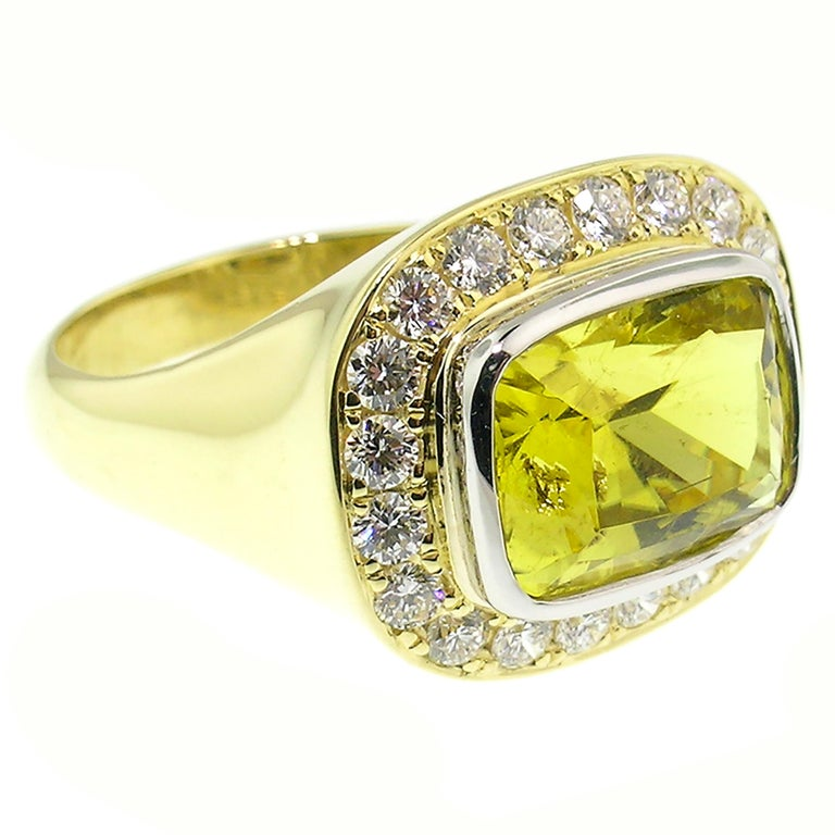 My bold Aphrodite ring pairs knockout scale with can't-miss-it voluptuous lines. This Aphrodite Ring features an electric-hued Canary Tourmaline accented by fine diamonds. Exquisitely cut, the dazzling color will absolutely radiate off your