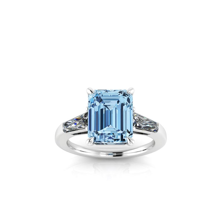 An exquisite 4.58 carat Aquamarine, emerald cut, very high quality color, eye clean gem, accompanied by two, tapered baguette, 0.40 carat total diamonds, G color, Vs clarity,  set in an hand crafted, delicate and sophisticated looking platinum ring,