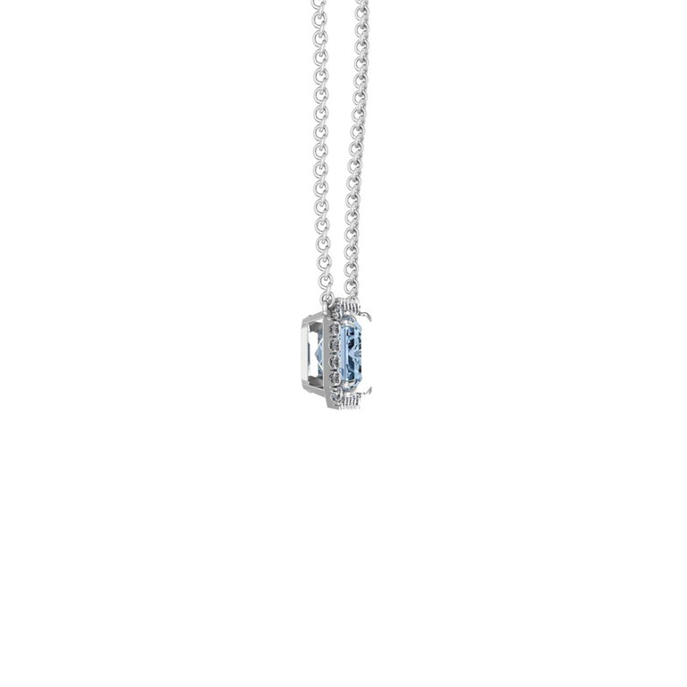 4.58 carat Aquamarine, emerald cut, very high quality color, eye clean gem, set in a made to perfection Platinum 950 double claw prongs with white diamond Halo of approximately 0.22 carat diamonds hand set. The necklace length can be adjusted at 18