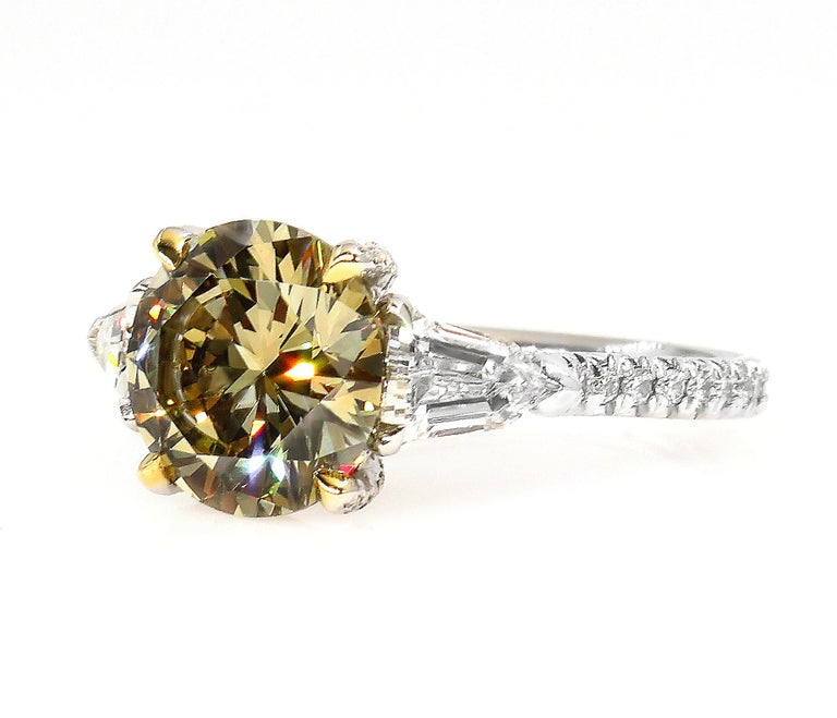 This is ring is just Beautiful! The Ultimate Luxury from our Fancy Colored Diamond Estate Collection. A SUPER RARE Find for Diamond Lovers and Rare Gems Collectors! More rare than a colorless diamond, a fancy color diamond is truly the most