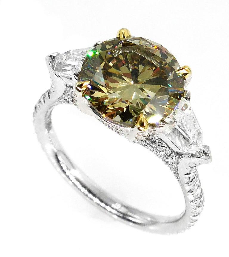 Round Cut 4.58ct Natural Fancy Brown Greenish Yellow Round Diamond 3-Stone Platinum Ring For Sale