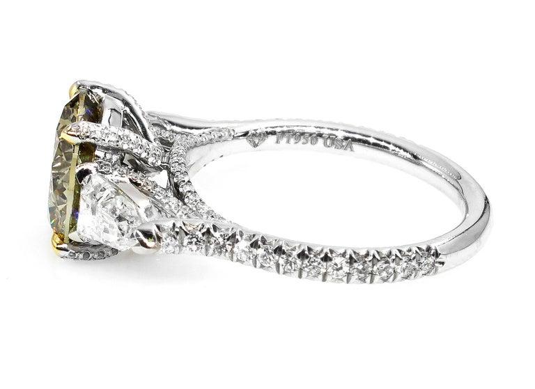 4.58ct Natural Fancy Brown Greenish Yellow Round Diamond 3-Stone Platinum Ring For Sale 1