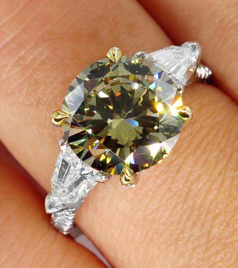 4.58ct Natural Fancy Brown Greenish Yellow Round Diamond 3-Stone Platinum Ring For Sale 4