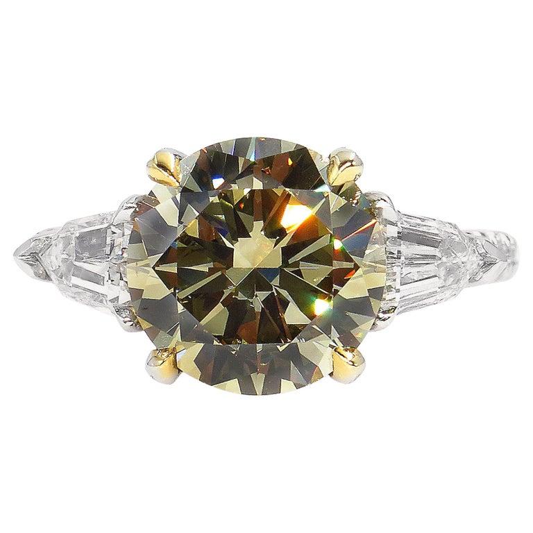 4.58ct Natural Fancy Brown Greenish Yellow Round Diamond 3-Stone Platinum Ring For Sale
