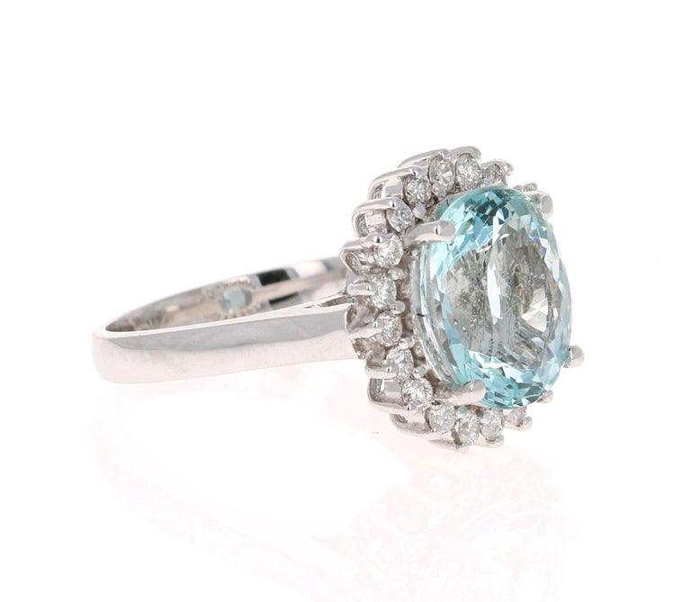 Stunning Victorian-Inspired Beauty!  This ring has a beautiful 4.07 Carat Oval Cut Aquamarine and is surrounded by 20 Round Cut Diamonds that weigh 0.52 carat (Clarity: SI, Color: F). The total carat weight of this ring is 4.59 Carats.   The ring is