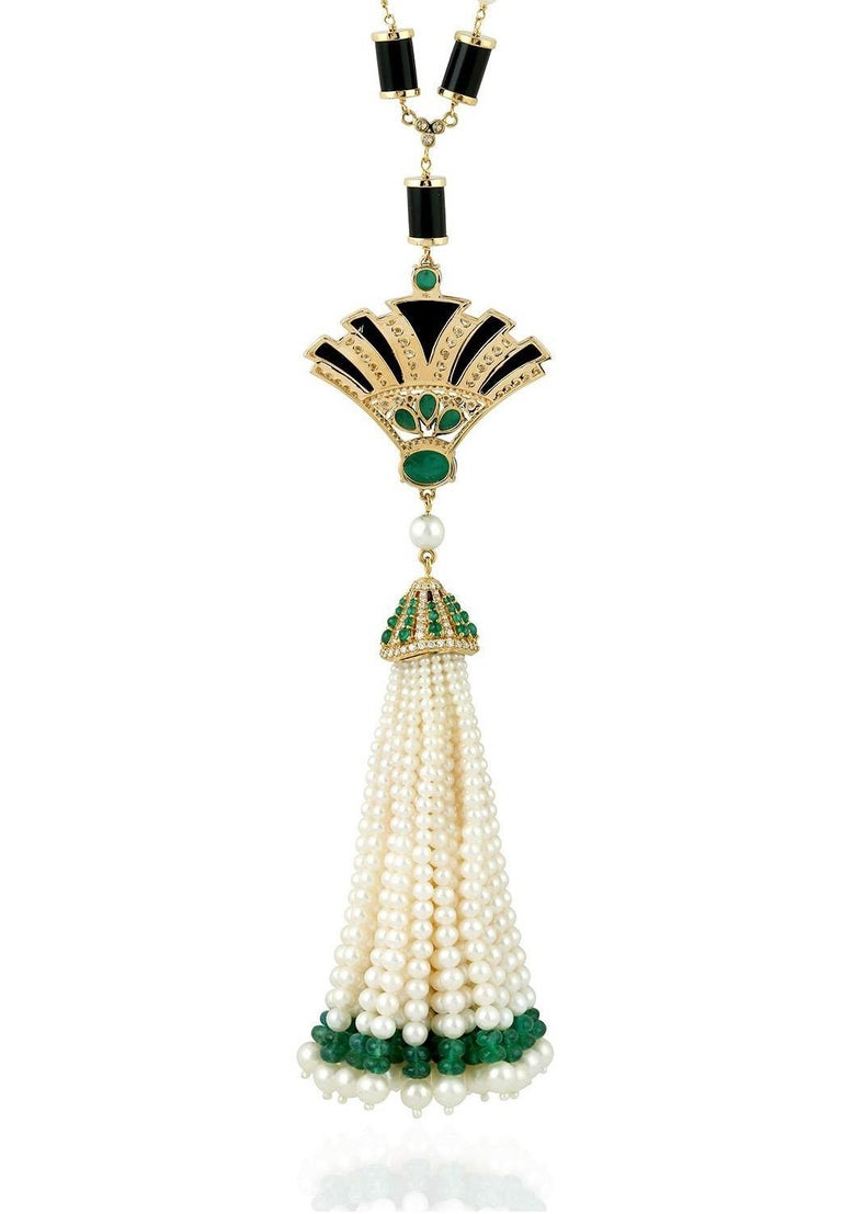 A stunning art deco tassel necklace is handmade in 18K gold. It is set in 45.96 carats of emerald, 36.87 carats onyx & 2.25 carats of glimmering diamonds. Clasp Closure  Please note that carat weights may slightly vary as each Meghna Jewels creation