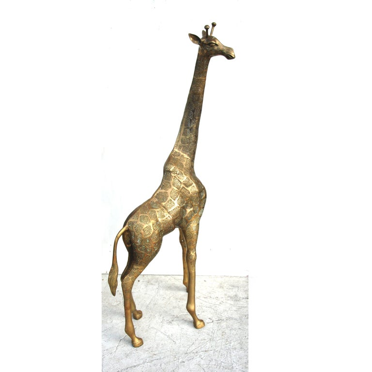 4.5FT Brass Giraffe   Hollywood Regency style floor statue, circa 1970s.   Standing over 4FT this statue has great presence and details.