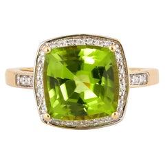 4.6 Carat Peridot with Diamond Ring in 18 Karat Yellow Gold